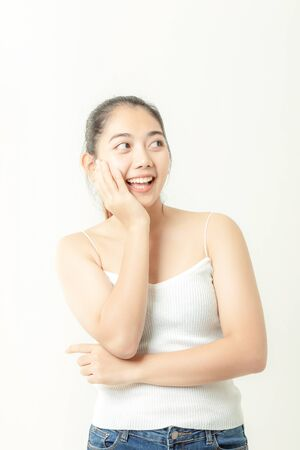 Asian woman is showing off pretty skin. Asian beauty skin care woman looking at side.