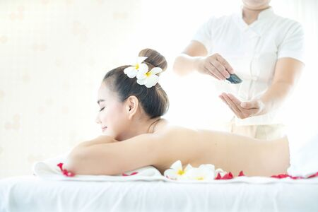 Beautiful woman in spa. Spa oil massage for relaxation. Asian woman in wellness beauty spa having aroma therapy massage with essential oil. Thailand.