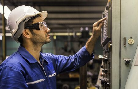 Young technicians factory worker controlling the work. Engineer checking and monitoring the electrical system in the industrial. Professional technicians are controlling industrial machinery.
