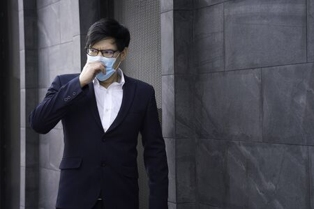 Social distance. Company employees wear a mask to work in the office. company employees wear protective masks to prevent PM 2.5 dust and virus COVID-19. Businessman air excessively smelling bad.