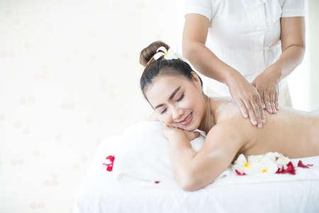 Asian woman massaging spa with salt.