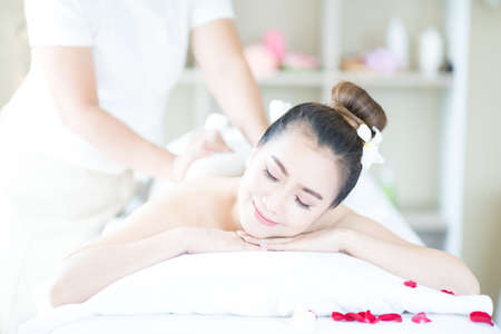 A young woman massaging the spa in the spa room Stockfoto