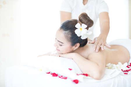 Asian woman massaging spa in window room Stockfoto - 152604299