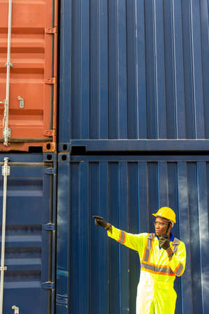 The employee is working in front of the container.