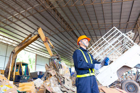 Engineer driving a loader in the recycling plant.