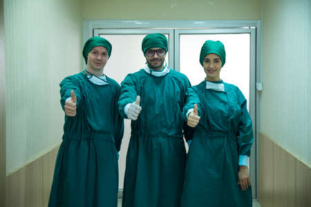 Surgery doctors raise their thumbs. Surgery doctors holds an excellent thumb.