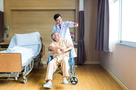 The doctor is encouraging a patient in a hospital room.