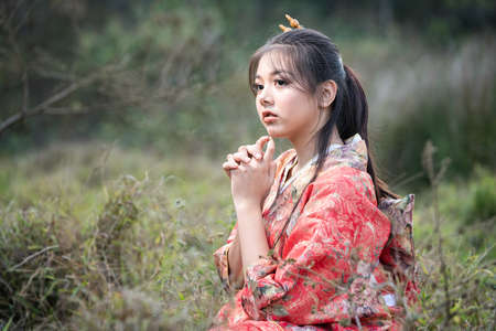 Asian woman tourists. Japanese girl wearing a kimono. Beautiful Female wearing traditional japanese kimono, Japan.