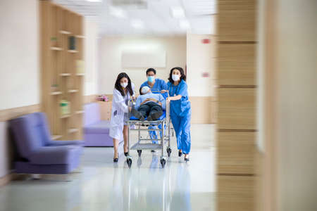 Group of doctor, Nurse and doctor in a hurry taking patient to operation theatre. Doctors running for the surgery. Team of doctors and surgeon rushing patient.