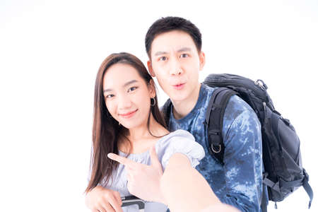 Young Couple video call and going on vacation in a foreign country. Young Couple selfie happy and go on the travel. Asian female and male travel on white background. Stockfoto