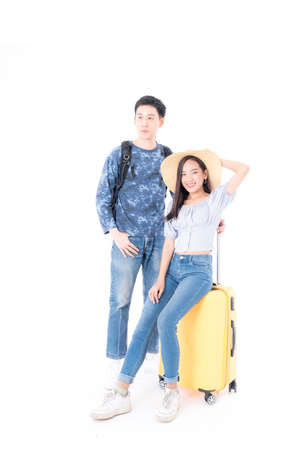 Young couple packing for vacation travel on isolated white background. Young Asian Male and female are preparing for the journey happily on white background. Stockfoto