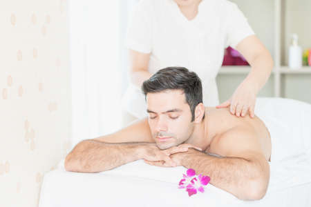 Man relax in skin care aroma therapy and scrub spa, in Thailand resort