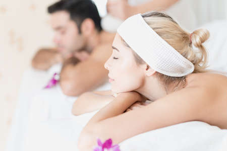 Young man and woman relaxing in a clean spa salon. Young beauty healthy female and young man resting in the spa salon. Stockfoto