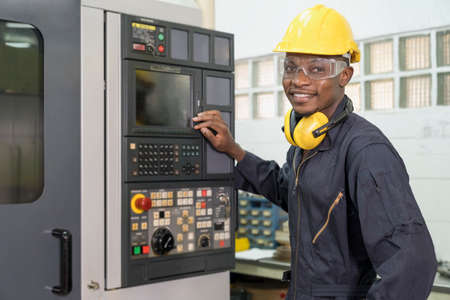 Professional technicians are controlling industrial machinery online. Engineer working and control robot with tablet. Young technicians factory worker controlling the work.
