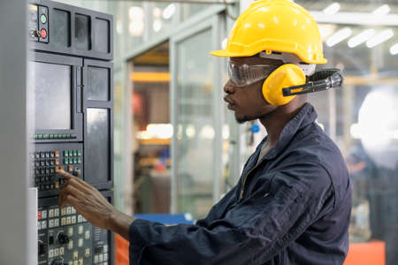 Professional technicians are controlling industrial machinery online. Engineer working and control machine in factory.