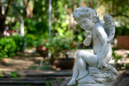 engel: Cupid in park Stock Photo