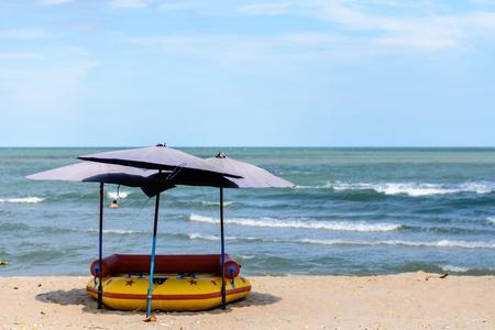 Umbrellas beach at beautiful beach with blue sky and deep blue sea Stock Photo