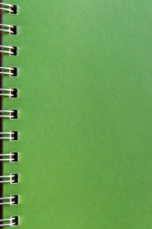 Green page of a recycle notebook. photo