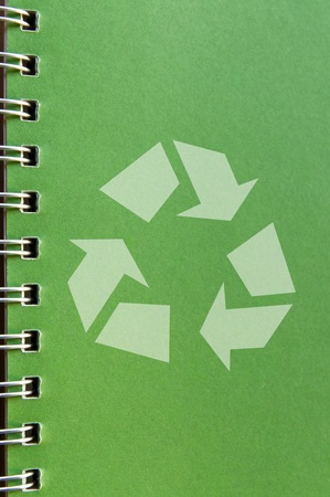 Recycle icon on green page of a recycle notebook. Stock Photo - 9900803