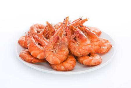 grilled shrimps on the white plate