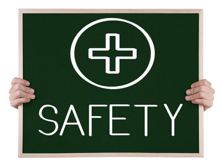 safety sign on blackboard with hands Stock Photo - 16689028