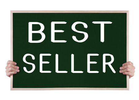 best seller: best seller  on blackboard with hands