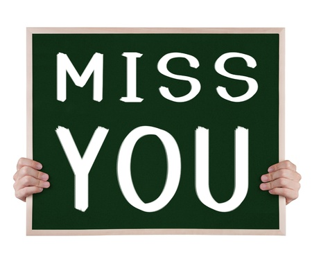 miss you: miss you on blackboard with hands Stock Photo