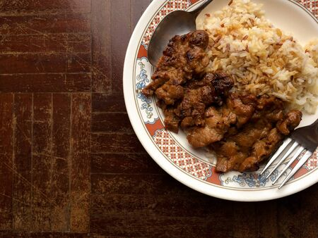 rice with grill pork and cooked with soy bean source ready to serve