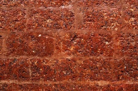laterite brick wall.Iron oxide in the earth provide red brown color of the soil.