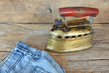 iron: Old days flat iron made of brass. The upper part with handle can be lifted up to fill with lit charcoal.