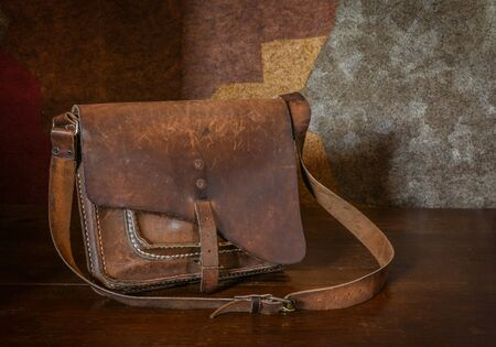 leather background: Still life. Vintage rustic leather bag.