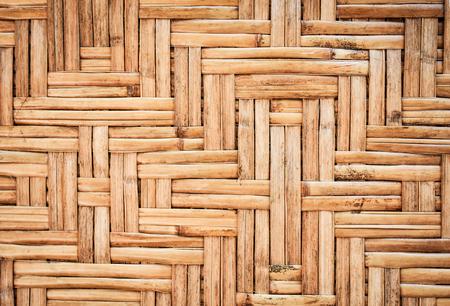 アジア農村地域における竹網代壁。部族の家の壁から竹テクスチャ背景。 写真素材