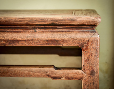 Detail of antique oriental wooden bench. Carpentry work,details finishing and patina of vintage furniture. Stock Photo
