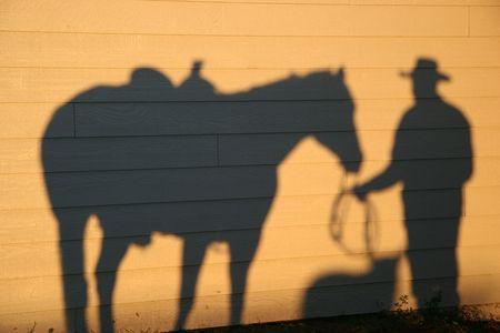 Shadows of Dog Horse and Cowboy
