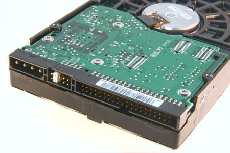A computer internal IDE (Integrated Drive Electronics) hard drive. Notice that the jumper is set in the slave position. This can be useful if a PC crashes and the master drive can be converted into a slave drive to recover the data. photo