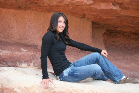 Pretty Teen Girl Sitting by Red Rocks