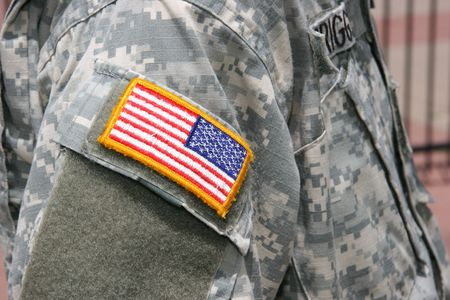veteran: Flag patch on the sleeve of an Army  soldier that has just returned from the Iraq war.
