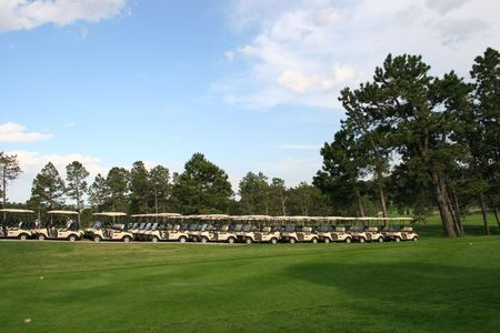 cart road: Golf Carts in a Row at a Country Club