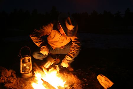 Cowboy By The Camp Fire Before Dawn