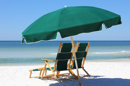 beach umbrella: two chairs and umbrella on white sand beach Stock Photo