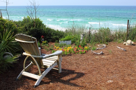 Chair and Flower Garden with Ocean View photo