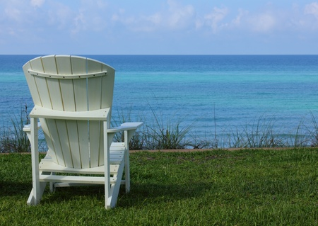adirondack chair: Beach Chair with Ocean View Stock Photo