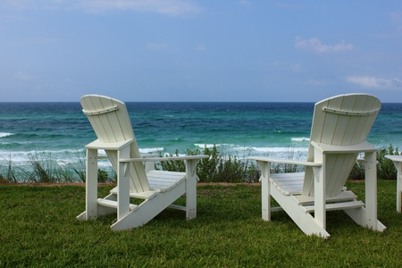 lounger: Two Adirondack Beach Chairs with Ocean View Stock Photo
