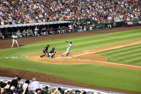 DENVER - JUNE 25: Jason Varitek, Red Sox catcher and team captain, gets a hit during the game with the Colorado Rockies at Coors Field June 25th, 2010 in Denver Colorado.