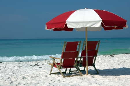 parasol: two chairs and umbrella on white sand beach Stock Photo