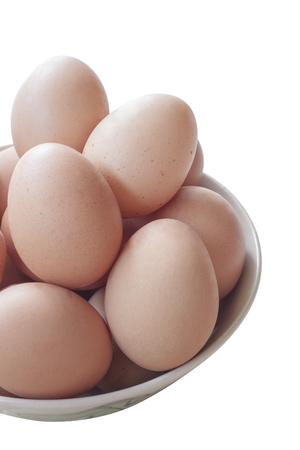 albumen: Eggs cooking for breakfast, a protein form yolk and albumen on a white background, or on a plain wooden table.