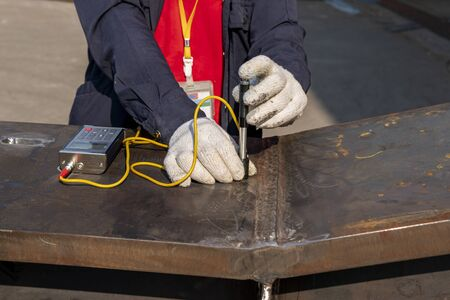 Brinell hardness test of steel and welded at heat affected zone(HAZ) after welding complete. Stock Photo
