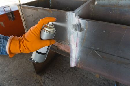 The step fourth of doing penetrant testing is step to use Developer spray into the welded to pull the liquid penetrate from the defect for Non-Destructive Testing with process Penetrant Testing(PT)