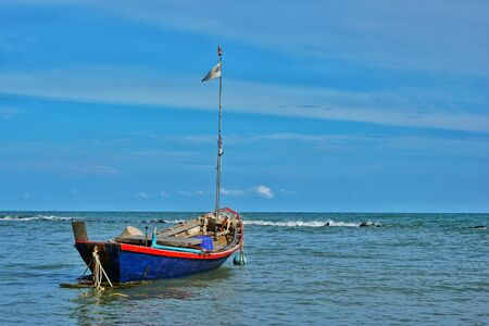 Fishing boats floating in the sea with blue sky