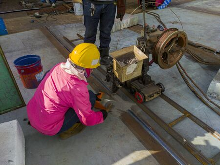The welder is welding add joint a steel plate with process Submerged Arc Welding(SAW) at industrial factory. Stockfoto